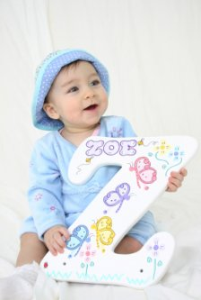 Baby Zoe playing  with the first letter of her name