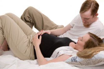 Young happy couple in childbirth class